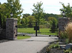 Stone pillar and sturdy steel gate