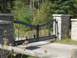 Custom Nature lover design steel gate with intercom/keypad and stone pillars