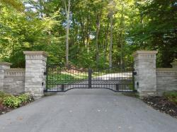 Another black steel gate with keypad and custom design