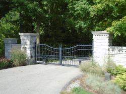 Black steel gate with keypad and custom design