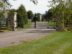 Black gate with custom front plate for logo or street number