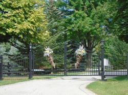 Complete gate and fence design in black with matching lamps.