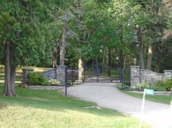 Stone Pillars and Black metal Gate with the works Blue Ridge