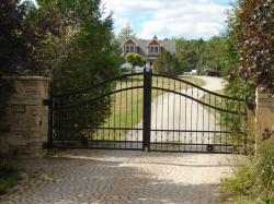 Stylish Black Metal Gate with Stone Pillars