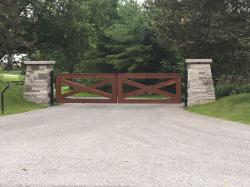 Simplistic Design Wood Gate With Stone Pillars & Intercom